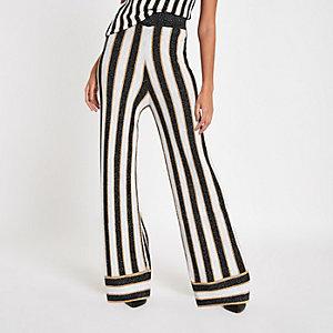 Pantalon large en maille noir à rayures métallisées