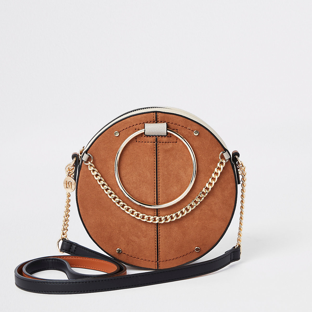 Beige ring handle circle cross body bag