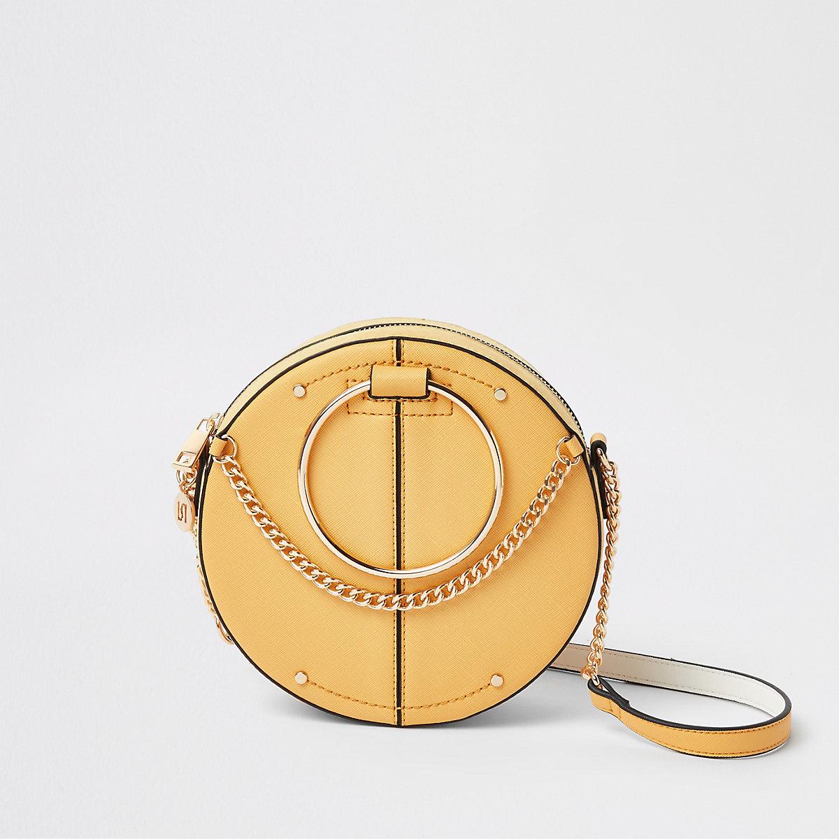 Dark yellow ring handle circle cross body bag