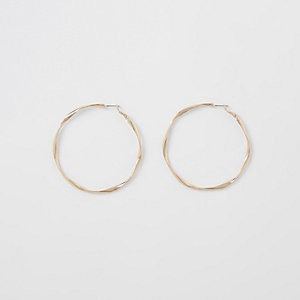 Gold color twist hoop earrings