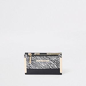 White zebra print mini foldout purse