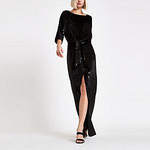 Zwarte fluwelen maxi-jurk met knoop voor en split