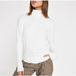 Cream batwing sleeve roll neck top