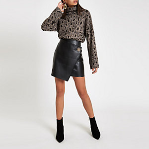 Black button side wrap mini skirt