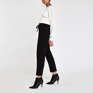 Pantalon fuselé noir à œillets
