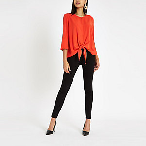 Red tie front long sleeve top
