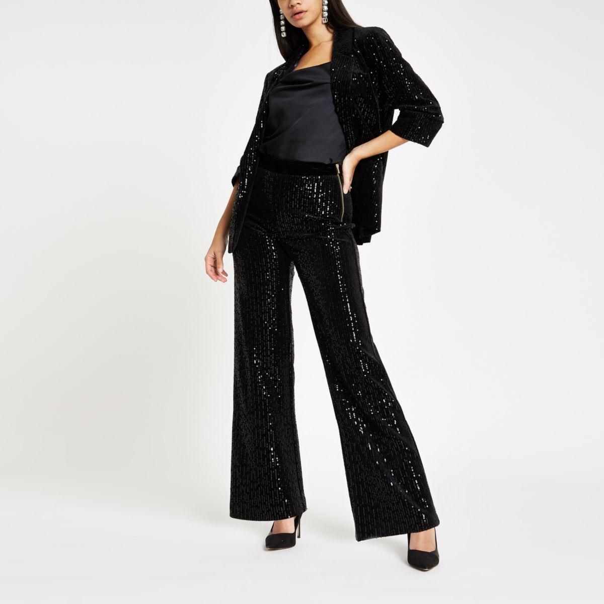 Zwarte fluwelen broek met wijde pijpen en lovertjes