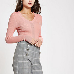 Pink ribbed knit V neck frill top