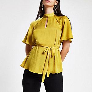 Gele blouse met strik voor en korte mouwen