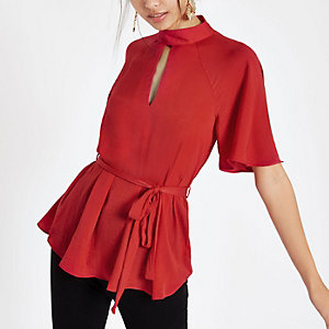 Red short sleeve tie front blouse