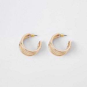 Boucles d'oreilles dorées à trois anneaux superposés