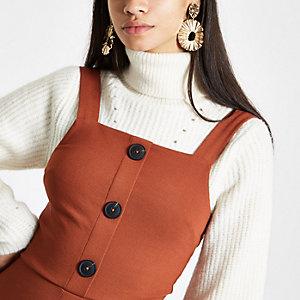 Orange button-up pinafore mini dress