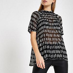 Zwarte plissé top met geometrische print