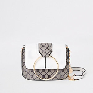 Beige monogram print cross body bag