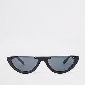 Zwarte zonnebril met half montuur en getinte glazen