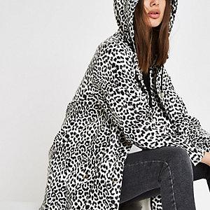 Witte regenjas met luipaardprint en capuchon