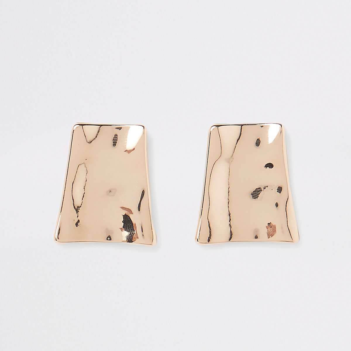 Gold tone battered trapezoid stud earrings