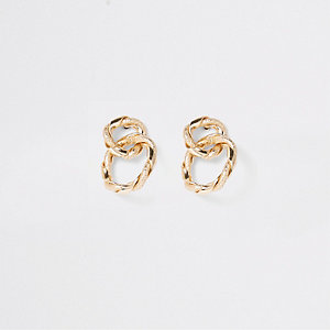 Gold tone twisted interlinked stud earrings