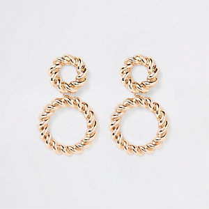 Gold tone twisted ring drop earrings