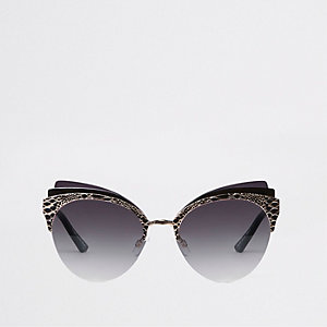 Goudkleurige cat-eye-zonnebril met drie lagen