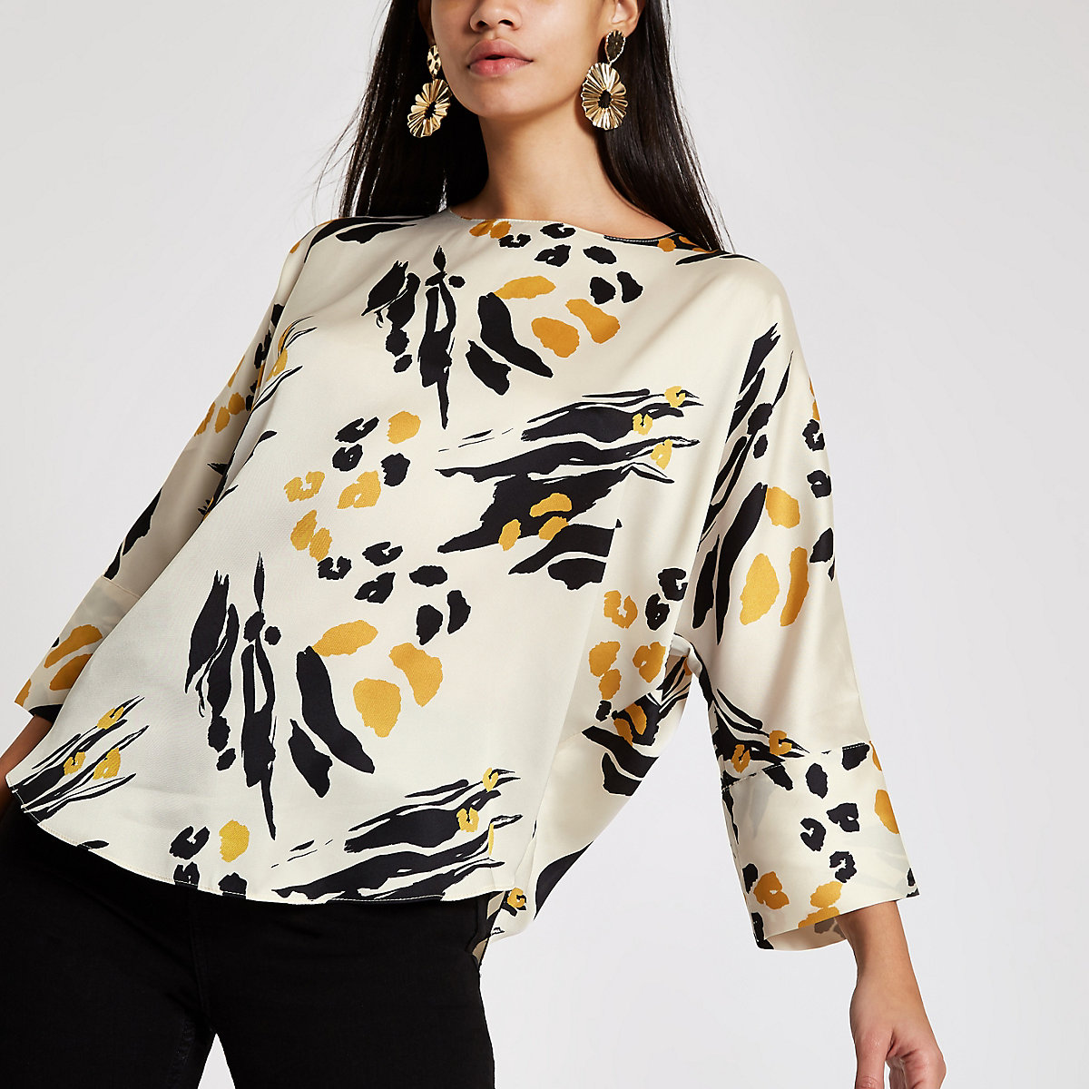 Cream abstract print batwing sleeve top