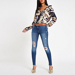 Mid blue ripped mid rise Molly jeggings