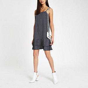 Marineblaues, gepunktetes Kleid