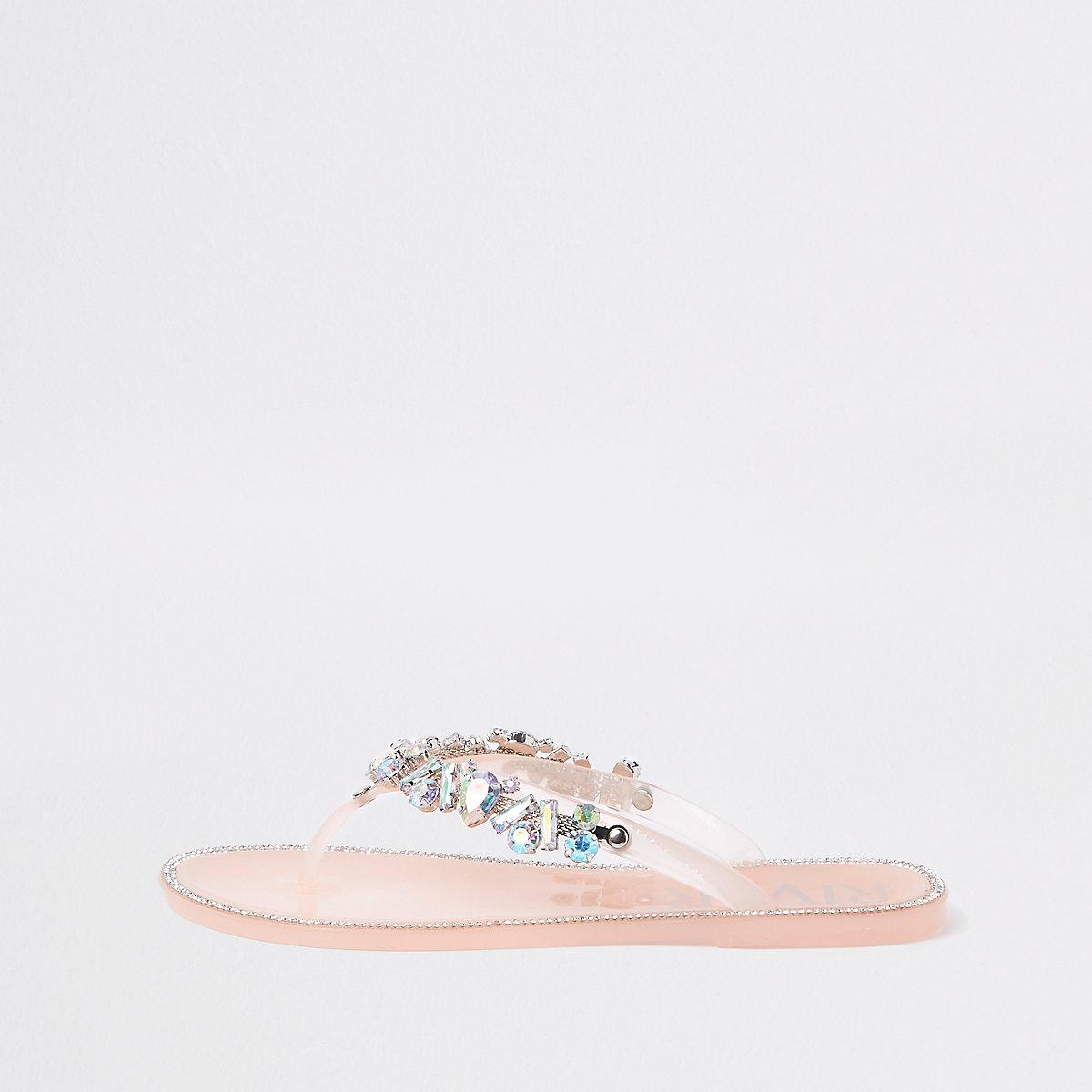 Light pink gem embellished jelly flip flops