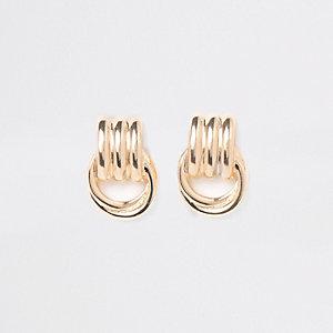 Gold tone doorknocker stud earrings