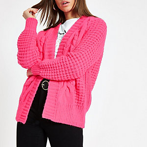 Bright pink cable knit cardigan