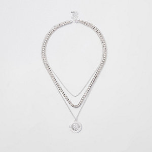 Silver pendant and curb chain necklace