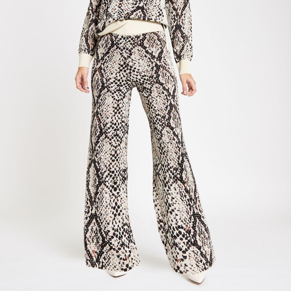 Pantalon large en maille à imprimé serpent crème
