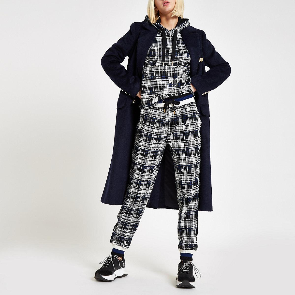 Pantalon de jogging à carreaux noir et empiècements contrastants