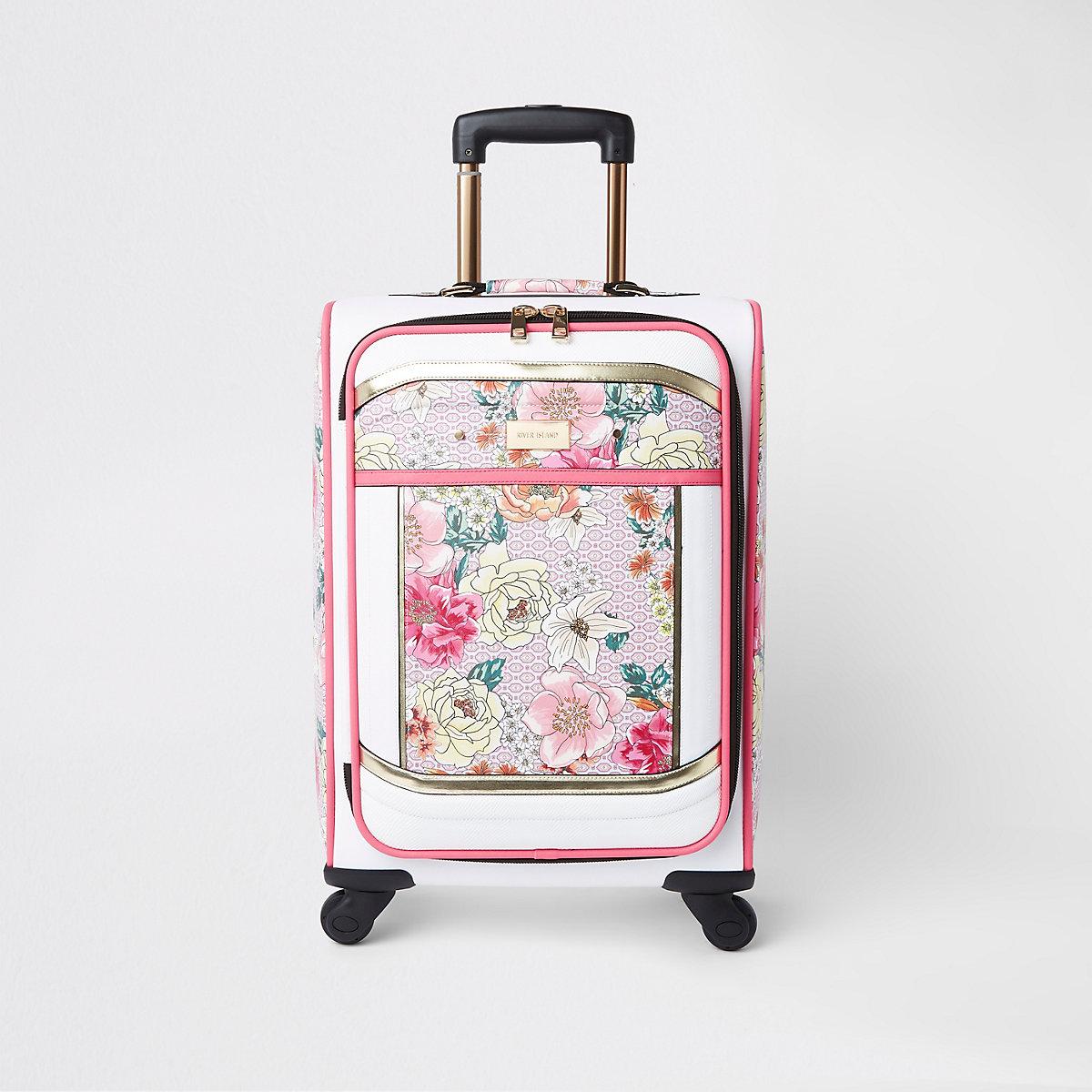 Light pink floral print four wheel suitcase