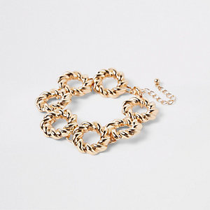 Gold colour twisted ring bracelet