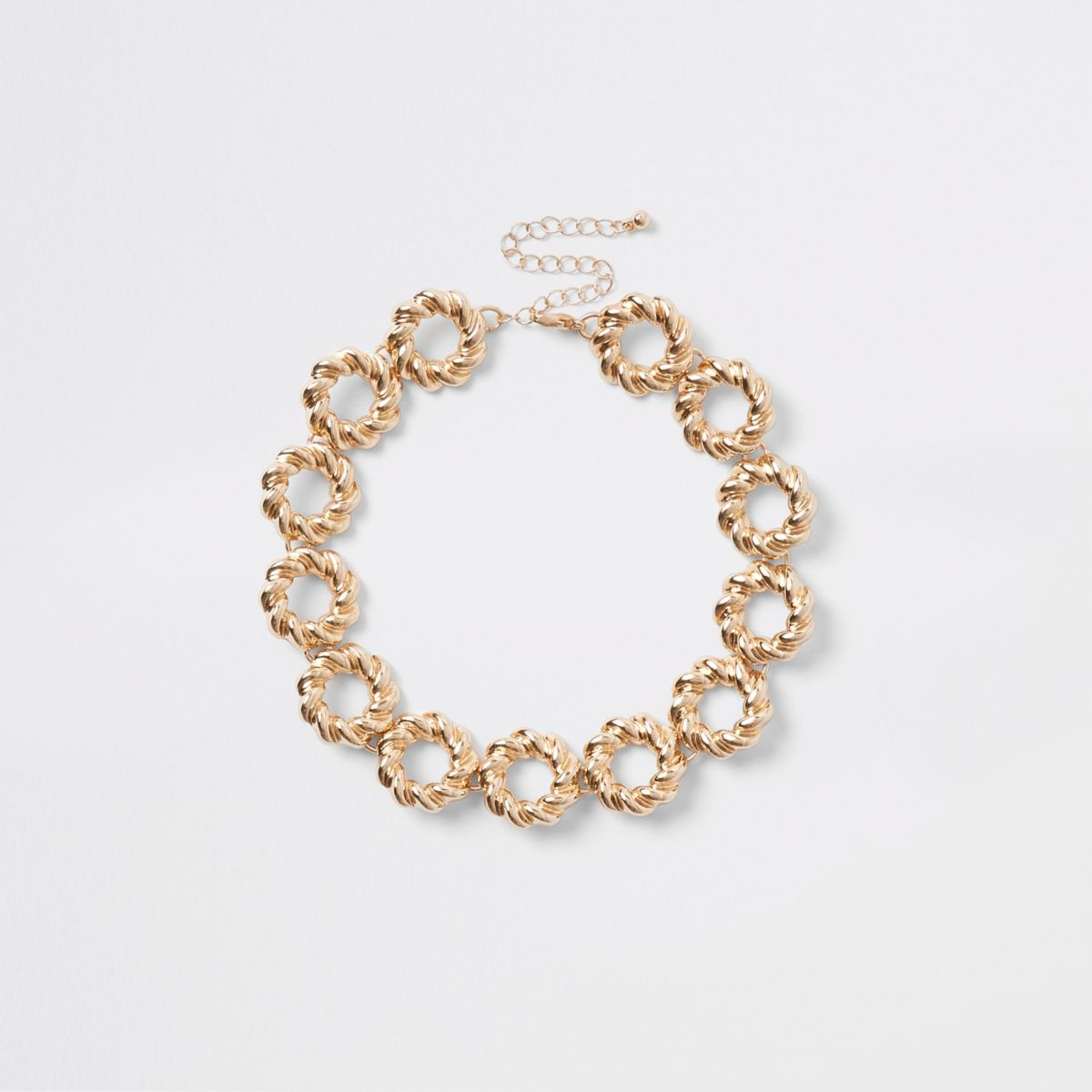 Gold tone twisted ring choker