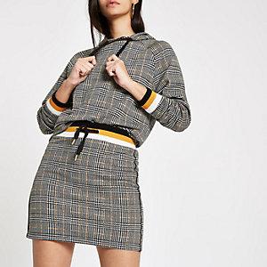 Mini-jupe en jersey à carreaux marron