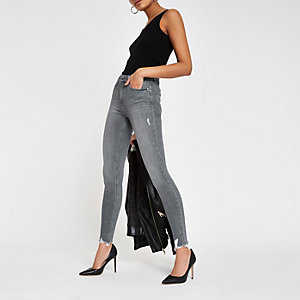Amelie – Graue Skinny Jeans mit Fransensaum