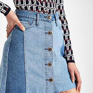 Mini-jupe en jean bleu moyen boutonnée sur le devant