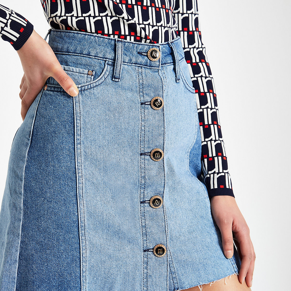 Mid blue button front mini denim skirt