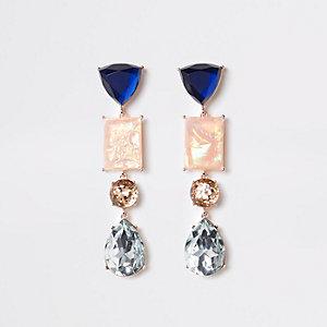 Pendants d'oreilles doré rosé avec pierre bleue