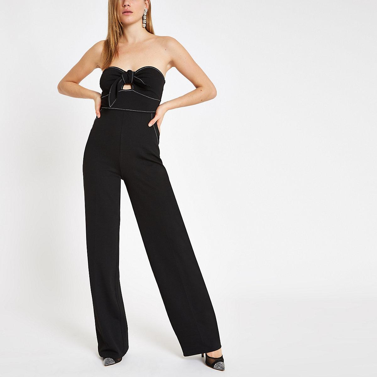 Zwarte jumpsuit in bandeaustijl met smaltoelopende pijpen en strik voor