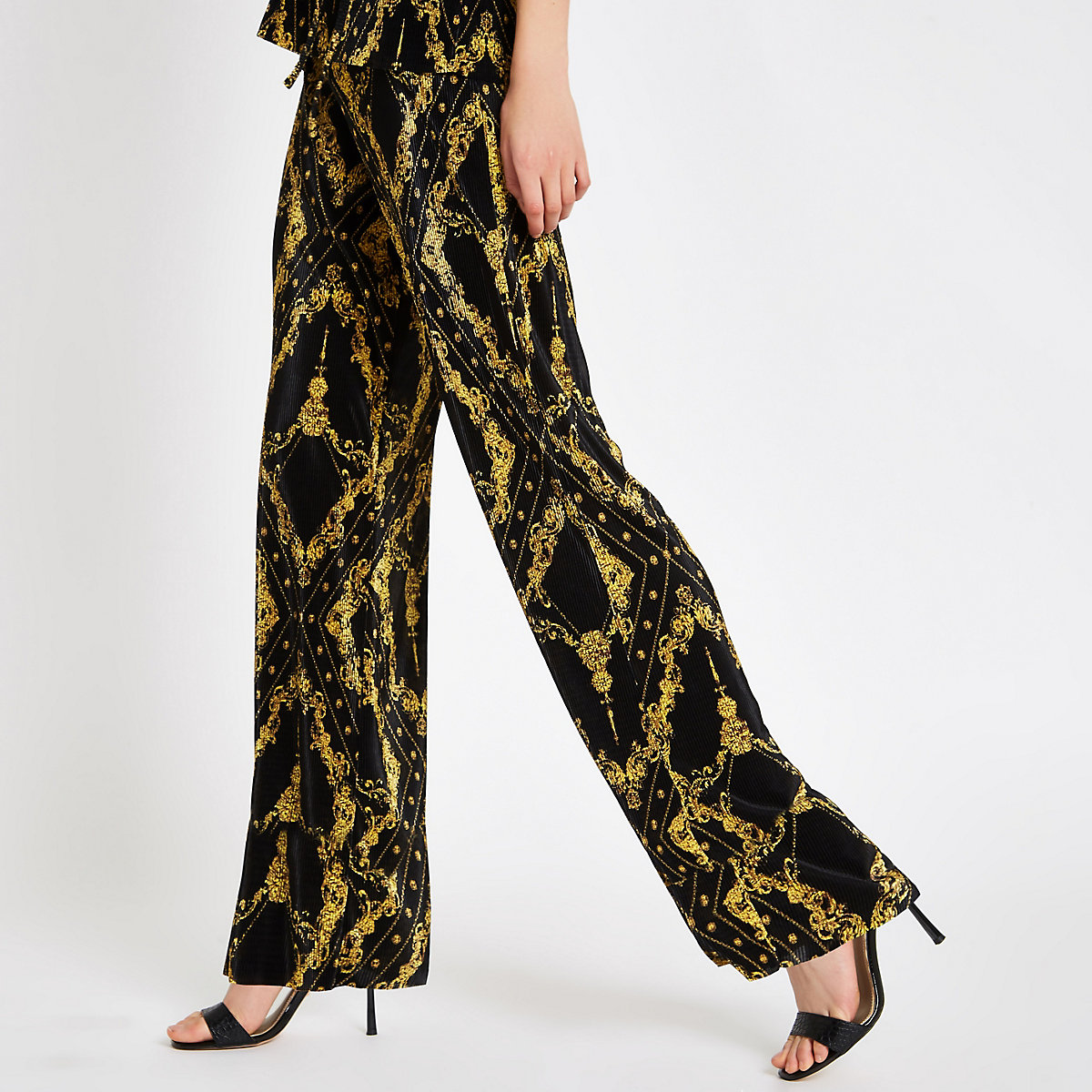 Black chain print plisse wide leg trousers