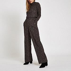 Zwarte jacquard broek met geometrische print en wijde pijpen