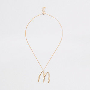 Gold tone large initial 'M' necklace
