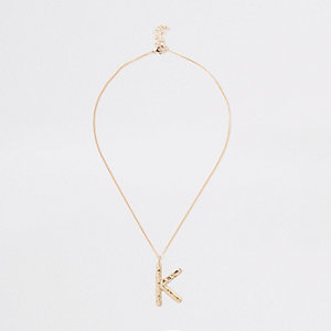 Gold tone large initial 'K' necklace