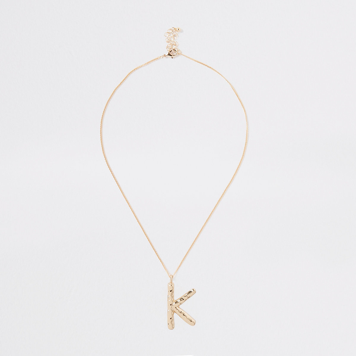Gold color large initial 'K' necklace
