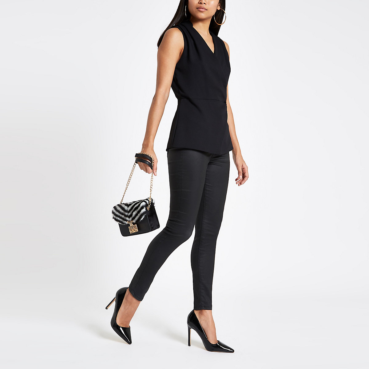 Petite black wrap front sleeveless top