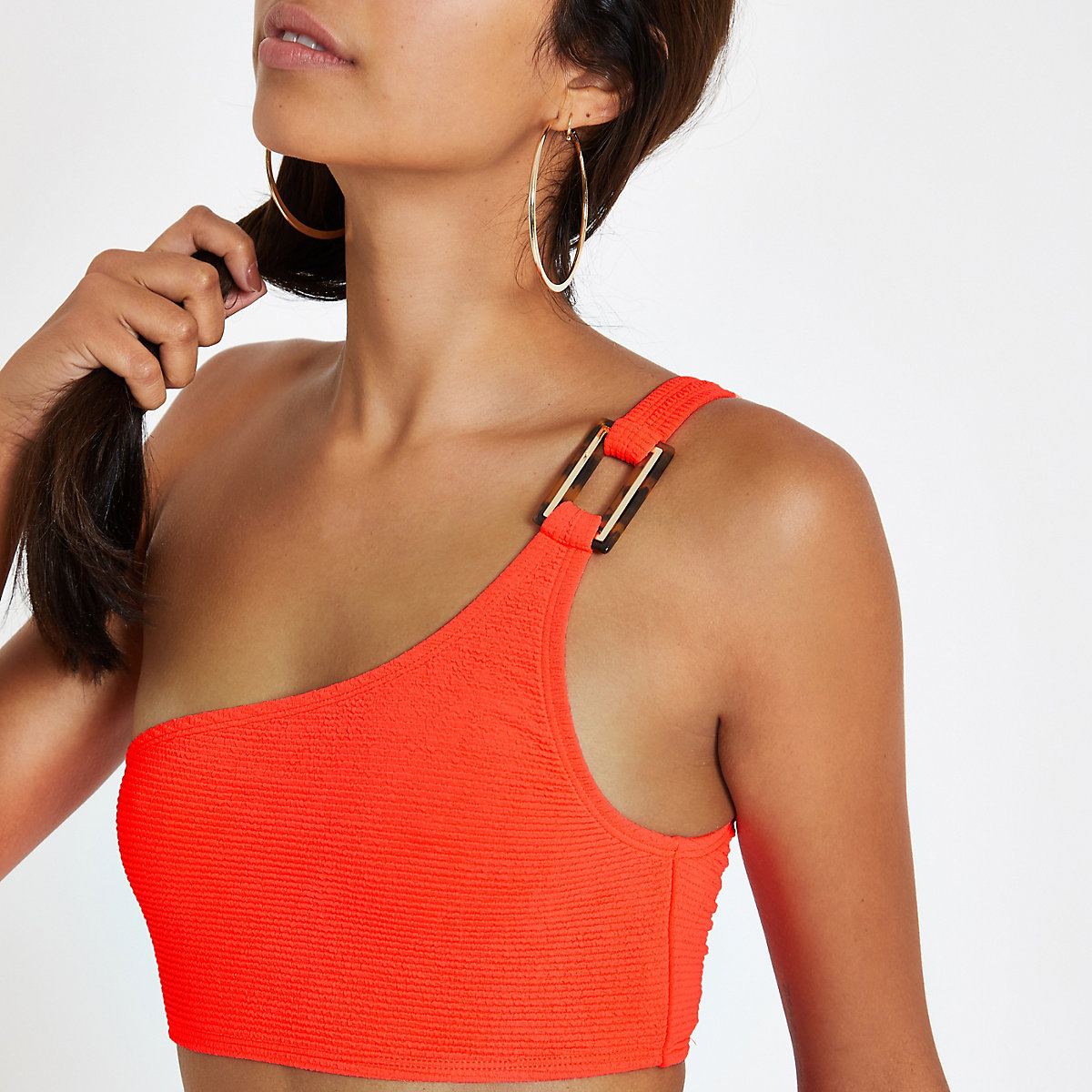 Orange textured one shoulder bikini top