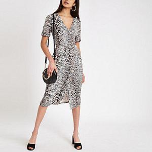 Bruine midi-jurk met luipaardprint en knopen
